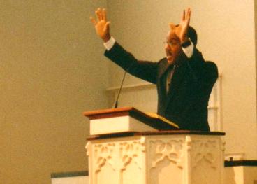 Mike Campbell preaching his first sermon at Redeemer Presbyterian Church, October 10, 2004.